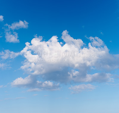A photo of white clouds and blue sky