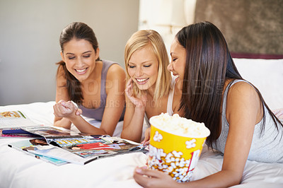 Buy stock photo Shot of three attractive young women having a ladies night in