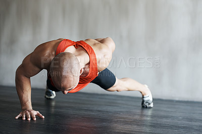 Buy stock photo Shot of a man working out at the gym