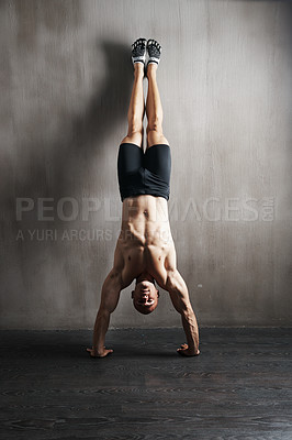Buy stock photo A man doing exercises at the gym