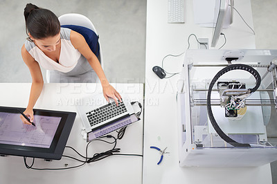 Buy stock photo Cropped shot of an attractive young woman working beside a 3D printer