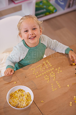 Buy stock photo High angle shot of a cute little girl doing equations using her breakfast at home