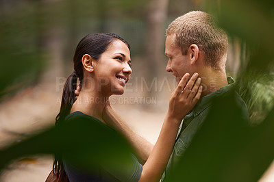 Buy stock photo Cropped view of a happy young couple standing together out in the park