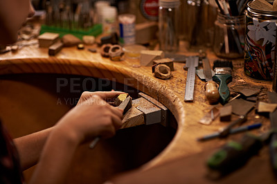 Buy stock photo A person using a tool to work on a piece of wood