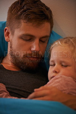 Buy stock photo A little girl asleep in her father's arms in bed