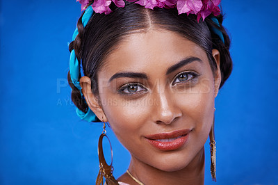 Buy stock photo A portrait of a beautiful young woman with a colorful headdress