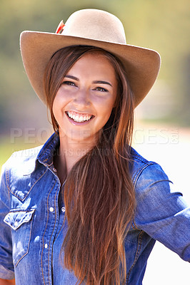 Buy stock photo A beautiful young woman in a cowgirl outfit standing outdoors