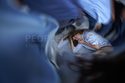 Buy stock photo Shot of a young woman curled up on the floor in a panic state