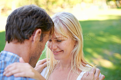 Buy stock photo Cropped shot of an attractive couple looking deeply into one anothers' eyes