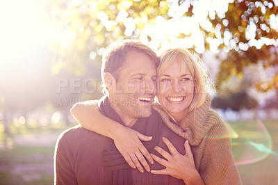 Buy stock photo Cropped shot of an attractive young couple at the park