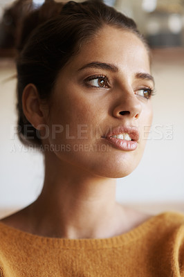 Buy stock photo A cropped shot of a beautiful young woman looking thoughtful
