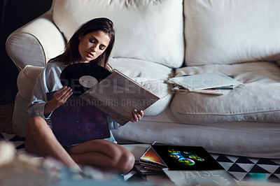 Buy stock photo Shot of an attractive young woman looking through her vinyl collection