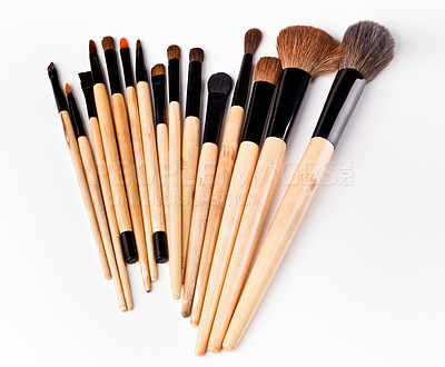 Buy stock photo Studio shot of a set of make up brushes spread out against a white background