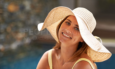 Buy stock photo Cropped view of a young woman smiling while wearing a sunhat