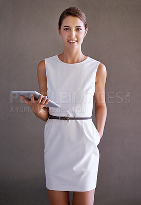 Buy stock photo Studio shot of a young woman holding a tablet pc