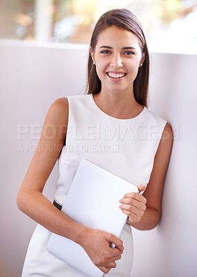 Buy stock photo Cropped shot of a young woman holding a tablet pc