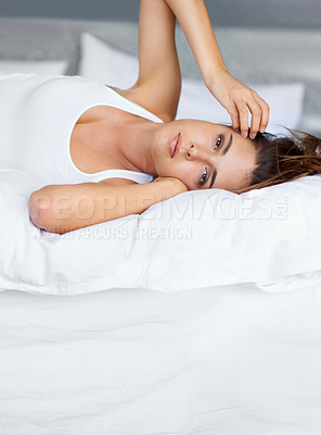 Buy stock photo Portrait of a beautiful young woman lying on her bed
