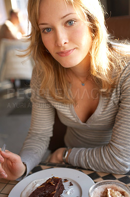 Buy stock photo Young Girl Enjoying a Chocolate cake at a restaura
