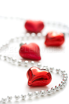 Buy stock photo Closeup heart-shaped christmas decorations and beads isolated on white with copyspace
