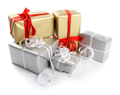 Buy stock photo A collection of christmas presents, isolated on white - copyspace