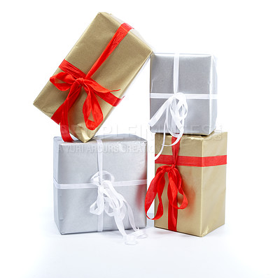 Buy stock photo Four christmas presents stacked up, isolated on white - copyspace
