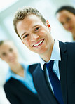 Blur image of a positive happy confident businessman smiling towards the camera