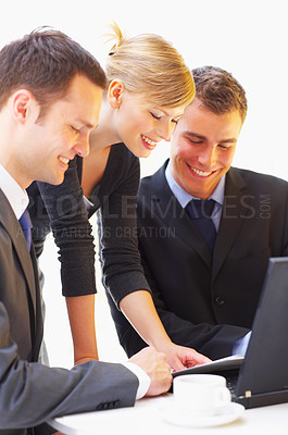 Buy stock photo Shot of a group of corporate businesspeople talking together over paperwork