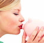 Profile image of young female kissing a piggybank over white background