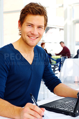 Buy stock photo Casual Young man with his laptop