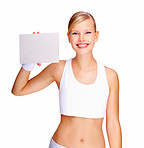 Smiling young female holding blank billboard isolated over white background