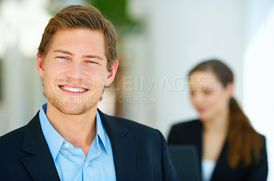 Buy stock photo Portrait of a young man in front of a workgroup