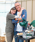 Happy mature couple renovating their home