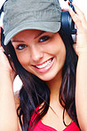 Cheerful young woman listening to music and smiling