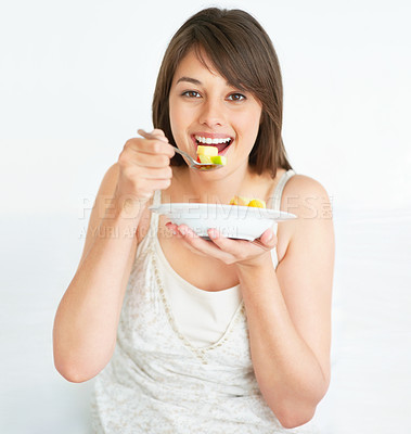 Buy stock photo Cute young female eating fruit salad