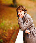 Young woman thinking - Autumn