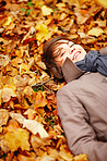 Seasons - Young woman lying in leaves