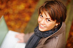 Portrait of a smiling woman using laptop in the forest