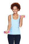 Smiling young woman working out with dumbells against white