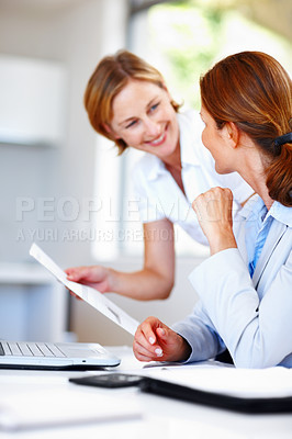 Buy stock photo A cropped shot of a secretary handing documents to her boss
