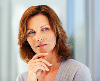 Buy stock photo Pretty young woman thinking about something