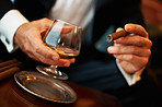 Wealthy man with cigar and cognac