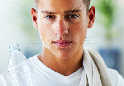 Buy stock photo Young man with water bottle after workout