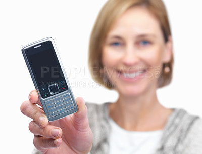 Buy stock photo Happy mature businesswoman displaying a cellphone