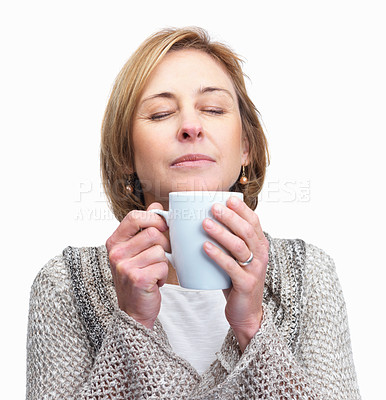Buy stock photo Pretty middle aged lady holding a cup of coffee  i