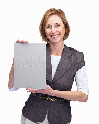 Buy stock photo Pretty middle aged lady holding a blank board isol