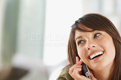 Buy stock photo Female speaking on the cellphone looking at copysp