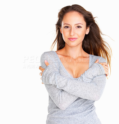 Buy stock photo Woman holding her arms against white background