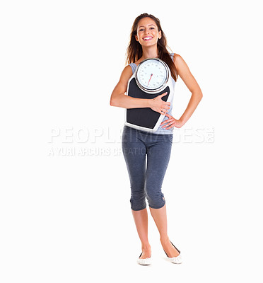 Buy stock photo Woman holding a scale against white background