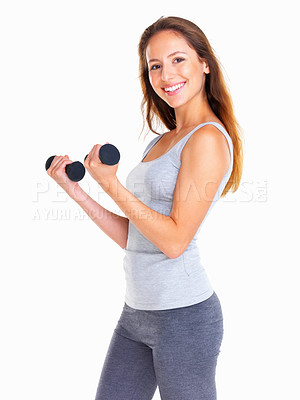 Buy stock photo Woman using dumbbells to work out her biceps