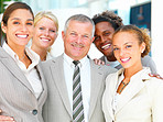 Portrait of smiling businesspeople standing together